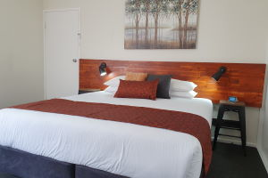 The King Bed within one of the Triple Rooms.